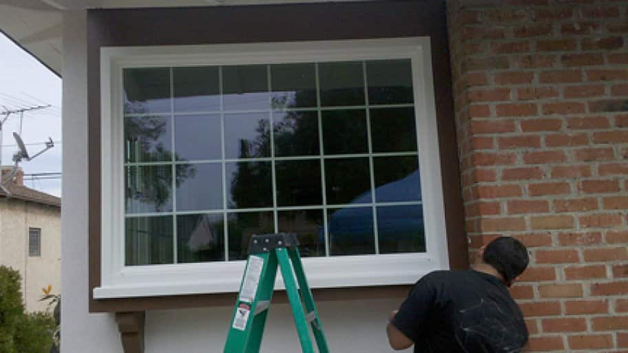 A contractor installs a tempered-glass window in a home. (Photo courtesy of Ian S. of Lakewood, California)