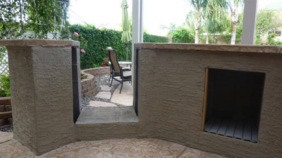 The space needed to be widened about seven inches and lowered about two inches in order for the new grill to fit. (Photo courtesy of Angie's List member Ronnie Blalack of Surprise, Ariz.)
