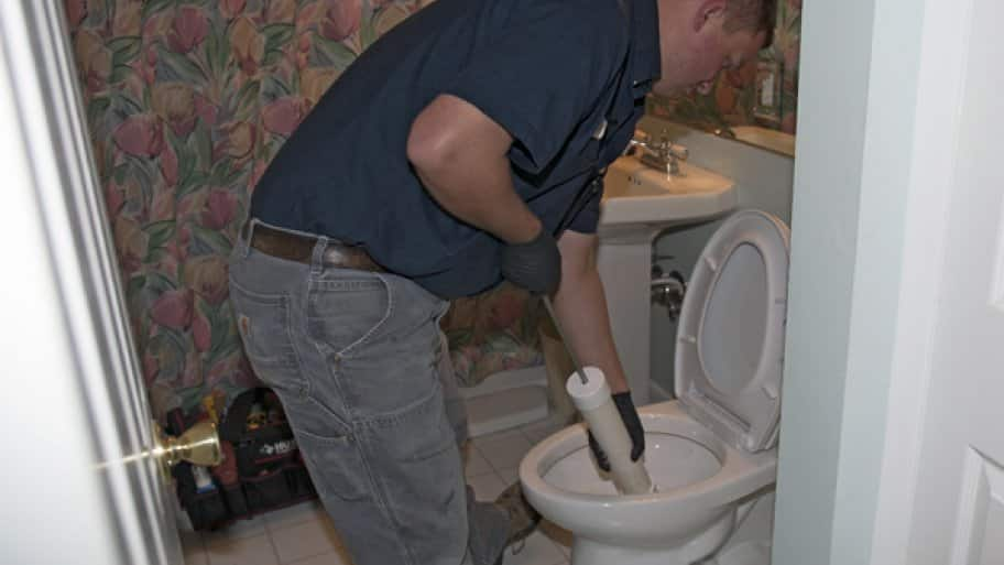 plumber working in a toilet