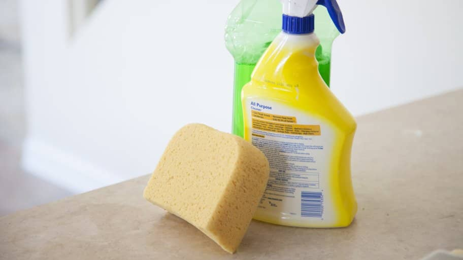 sponge on counter with cleaning products