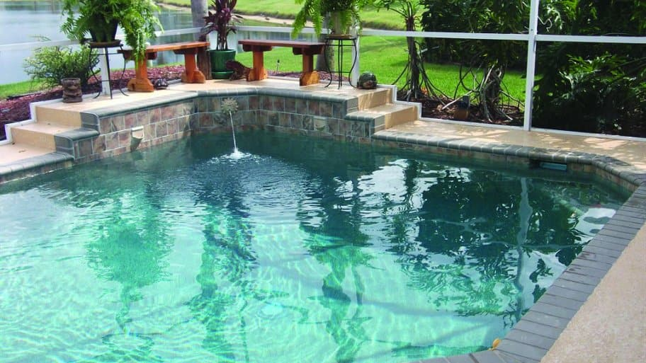 outdoor pool with landscaping