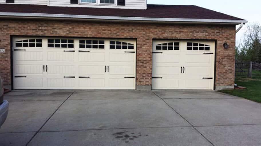 Running car in garage with door open