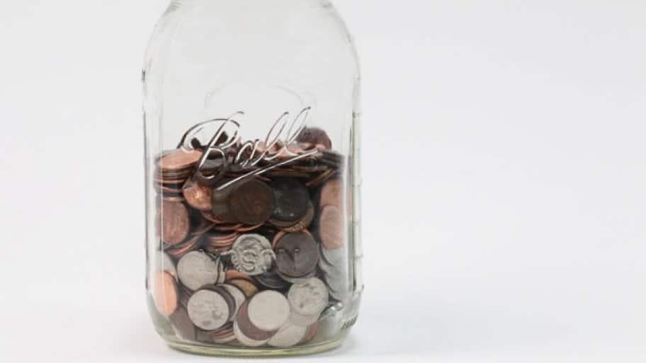 a mason jar containing coins.