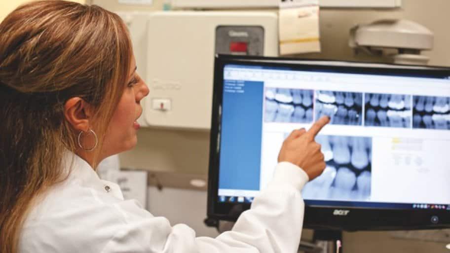 Dr. Samira Mahabadi points to a molar on a dental x-ray