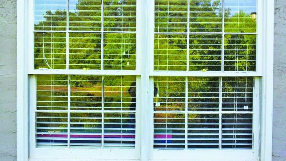 Windows sit with blinds partially open inside. (Photo by Photo courtesy of Bill Myrick)