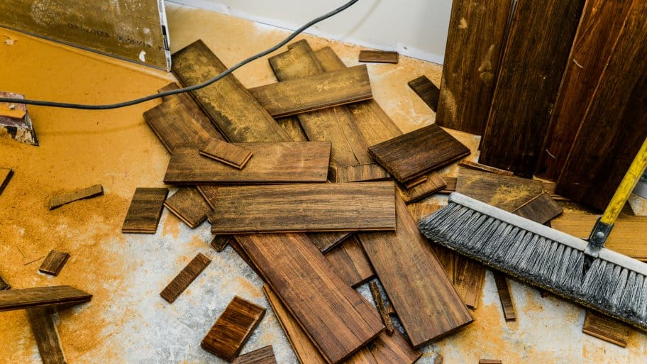hardwood flooring scraps covered in sawdust
